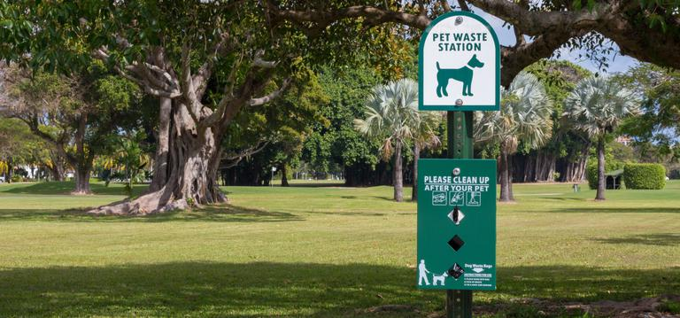 Pet waste station at a park in the city of coral gables.