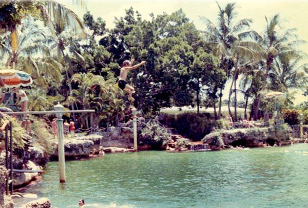 Historical photo of venetian pool. Kid jumping off waterfall.