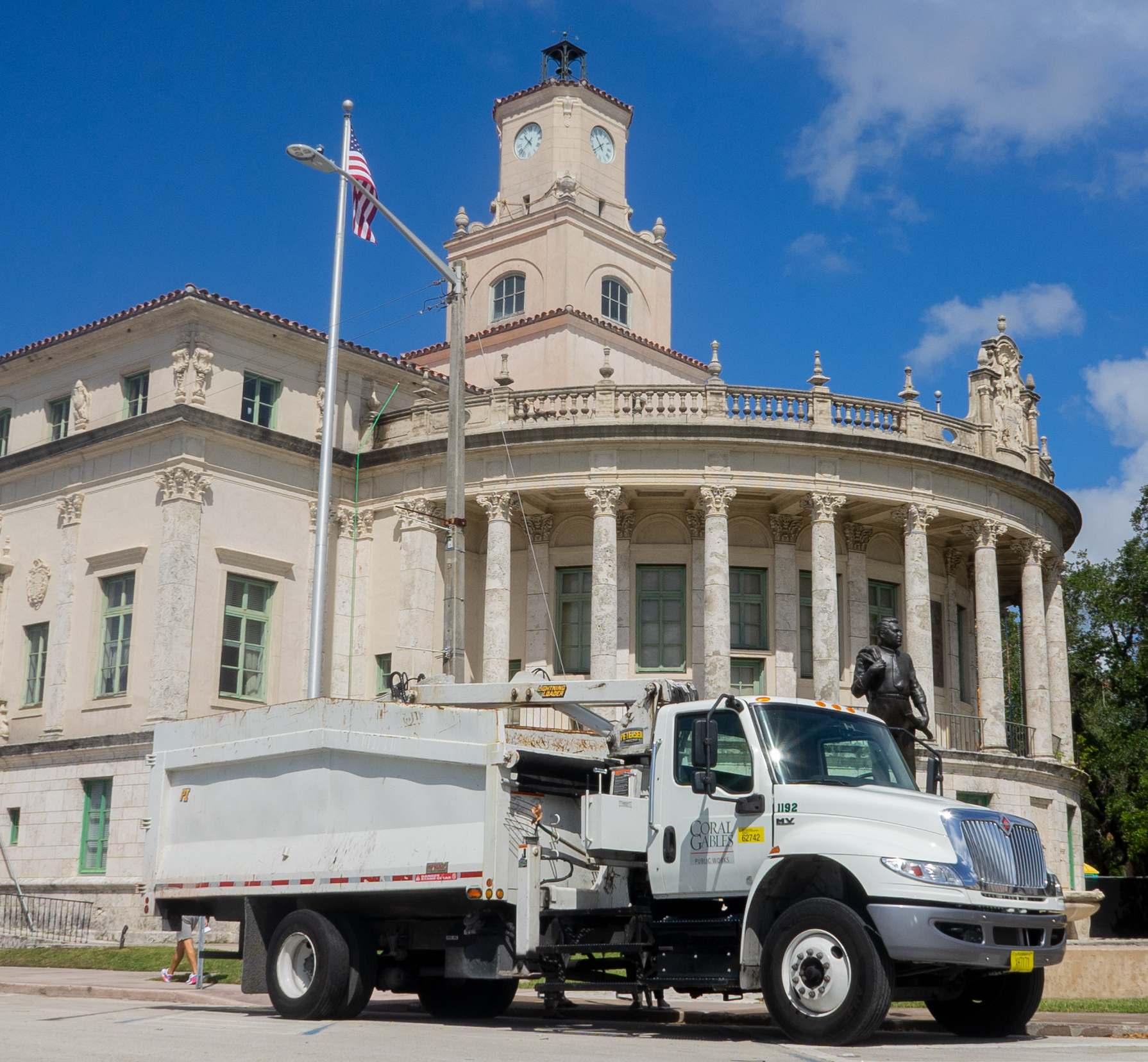 A coral Gables garbage truck in front of City Hall