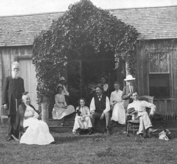 Family outside first home